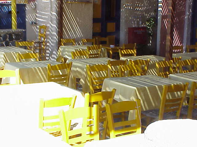 Yellow chairs in cafe, Oia
