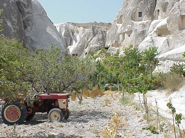Tractor, cave houses,              Goreme