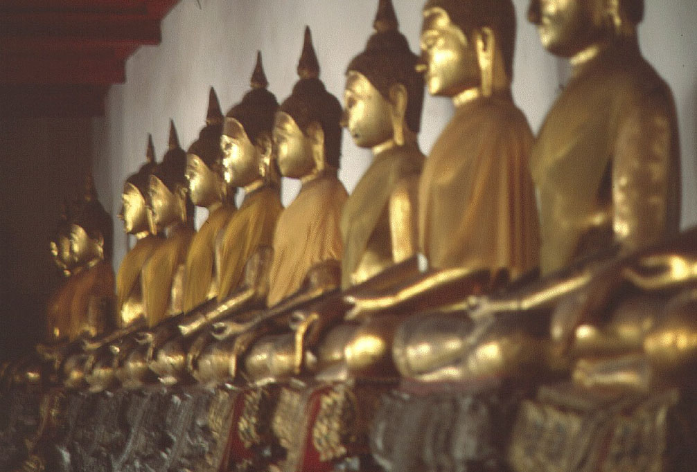 row of golden Buddhas  BANGKOK